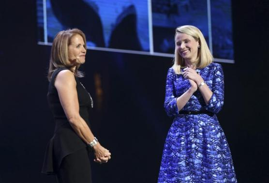 Yahoo CEO Marissa Mayer greets journalist Katie Couric on stage during Mayer's keynote speech at the annual Consumer Electronics Show (CES) in Las Vegas